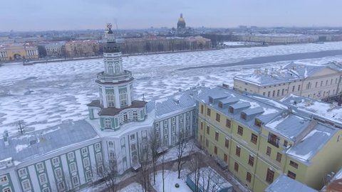 Aerial view Saint Isaac's Cathedral in St.Petersburg Russia. Neva River covered in ice and snow. Winter day, dramatic mood. Unique cinematic 4k drone aerial footage. Accent and drift. City panorama