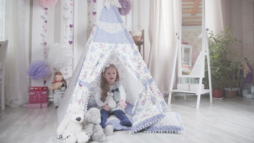 Little cute girl with blond hair sitting in a toy house surrounded by soft toys.  sc 1 st  Shutterstock & Little Cute Girl Lying On The Floor In The Nursery In Tepee Tent ...