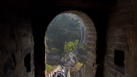 Great Wall of China. Majestic mountain vista. Beijing Mutianyu. Ancient historic site. Autumn orange sunset, yellow green tree. Forward pass tower gate