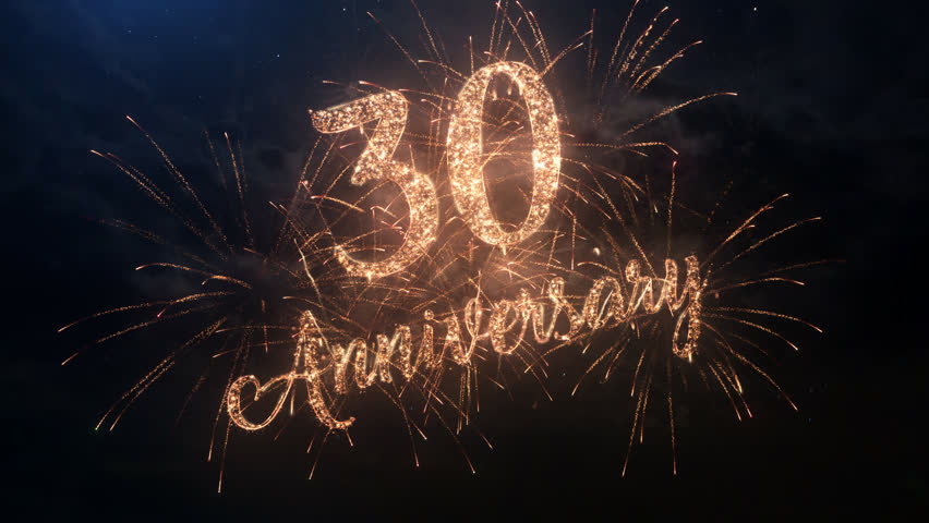 Happy birthday Anniversary 30 years celebration greeting text with particles and sparks on black night sky with colored slow motion fireworks on background, beautiful typography magic design. | Shutterstock HD Video #24176431