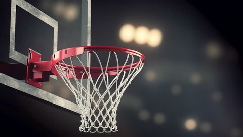 Throw in a basketball hoop on the background of yellow spotlights, the ball hits the ring is what flying through the net, loopable (4k, 3840x2160, ultra high definition, seamless loop)