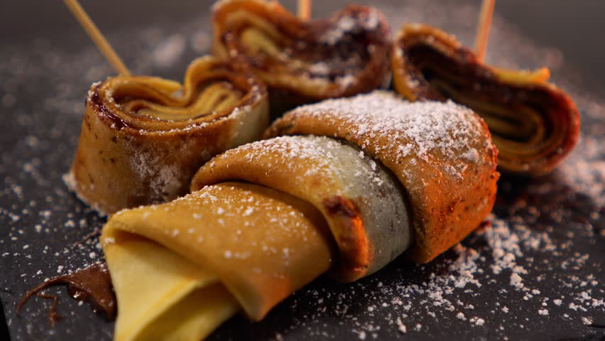 A speciality from France - French Crepes or pancakes with chocolate   Shutterstock HD Video #24200953