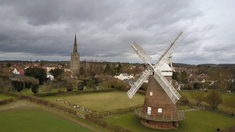 Traditional English windmill, Thaxted, Essex. Drone video footage of the Essex town of Thaxted dominated by a traditional old English windmill and Parish Church on an overcast February day.