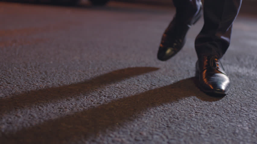 Close Up of an Elegant Male Shoes walking on the Streets at night in Slow motion.