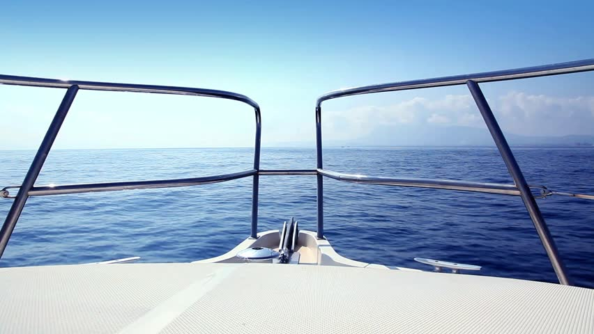 Boating in blue Mediterranean sea view from boat bow deck