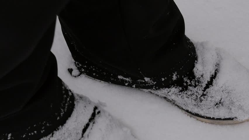 Closeup shaking the snow off feet winter | Shutterstock HD Video #24227251