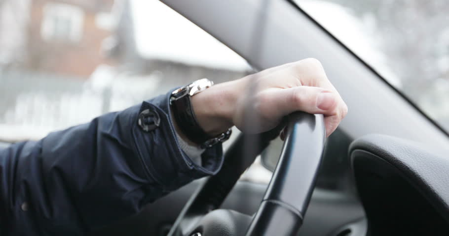 4K Close up of man's hands is on steering wheel. A male looks time on a wristwatch. Traveling by car. Car on the go. | Shutterstock HD Video #24279023
