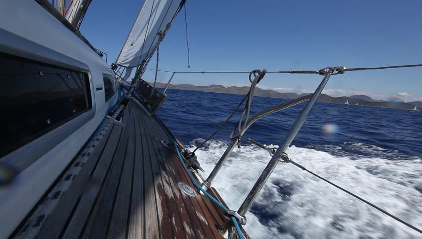 Sailing in the wind through the waves (HD) Sailing boat shot in full HD at the
