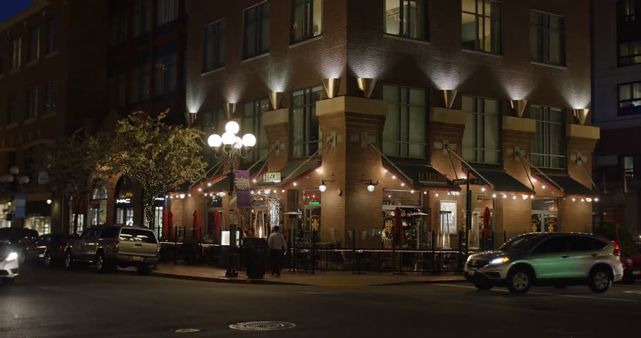 SAN DIEGO, CA - Circa February, 2017 - An evening establishing shot of a typical upscale bar and restaurant on Fifth Avenue in San Diego's Gaslamp Quarter.