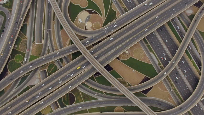 Aerial view of traffic junction with cars. The concept of the urban form of Dubai, UAE | Shutterstock HD Video #24355223