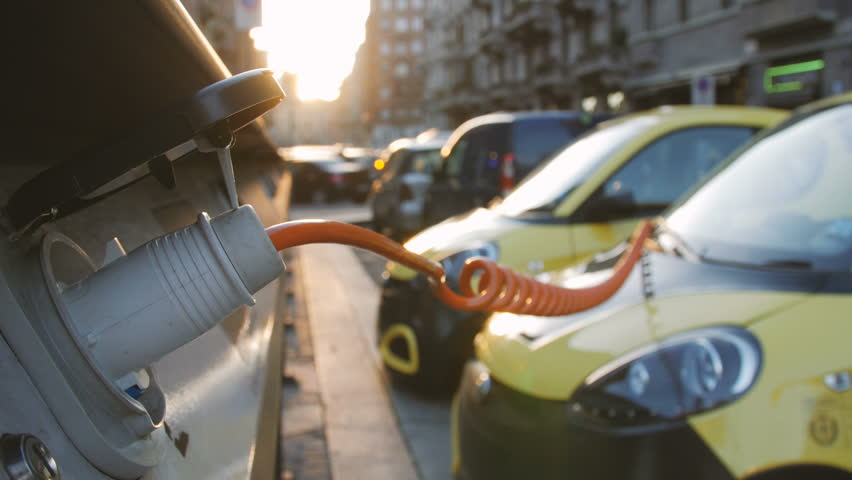 Small yellow electro cars is charging in the street station. Close-up. | Shutterstock HD Video #24378983