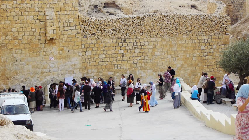 MAR SABA, PALESTINE -NOVEMBER 6: Pilgrims near Saint Savas monastery on November 6, 2011 in Mar Saba, Palestine. Mar Saba or Saint Savas monastery is the oldest monastery in Historical Palestine