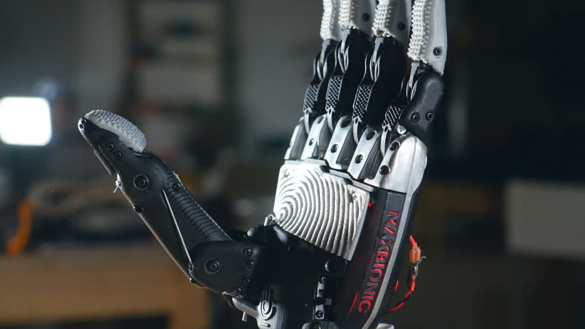 Real innovative bionic cybernetic man gesturing. Futuristic arm moving fingers. Close up.