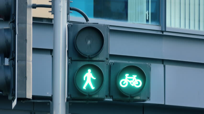 Traffic light turns red to green to signal pedestrians and bicyclists to go
