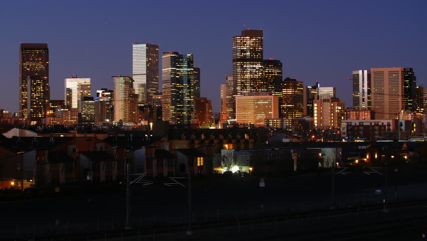 Beautiful view of the Downtown Denver skyline. Night to day timelapse. Full sunrise, from darkness to bright sun. 4K UHD.