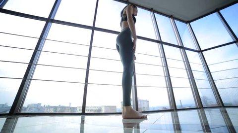 Beautiful model doing yoga exercises, flexible girl,