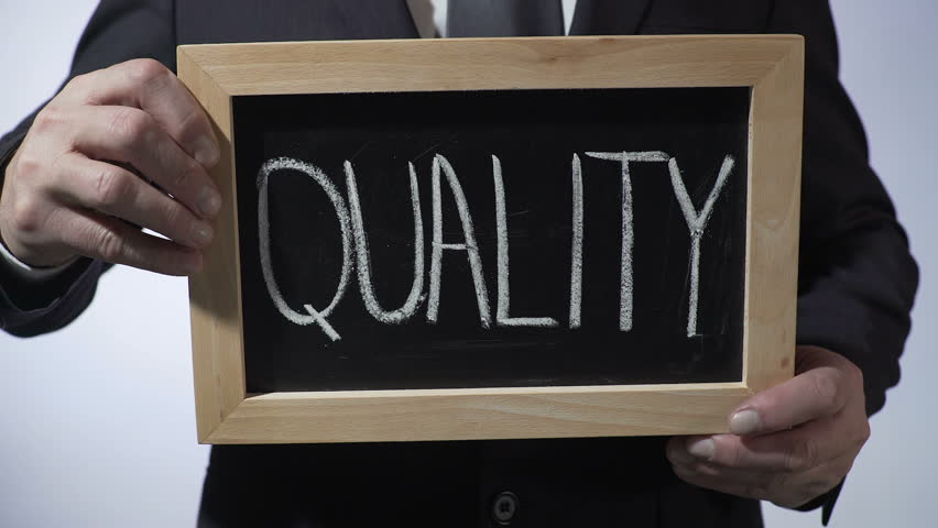 Quality written on blackboard, businessman holding sign, business concept | Shutterstock HD Video #24503363