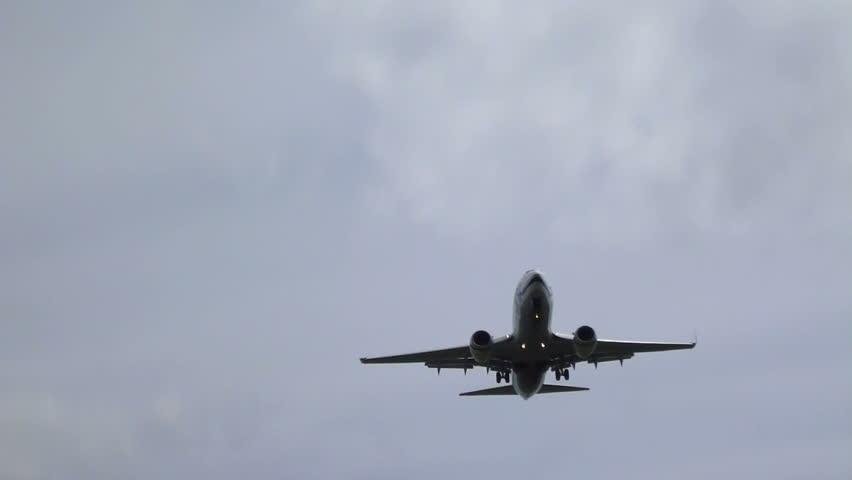 Portland, Oregon USA June 2012 - Commercial passenger airplane flying overhead
