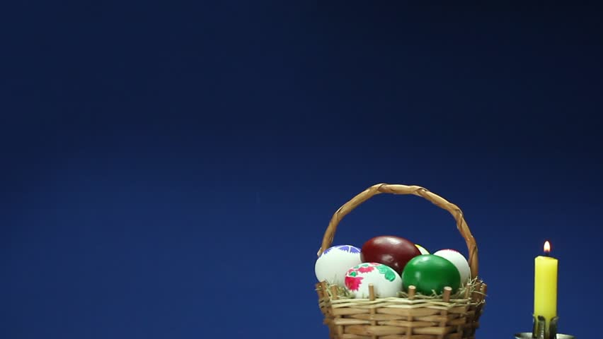 Easter bunny in an easter basket stock footage video 2191564 on a blue background revolves wicker basket with hand painted easter eggs hd stock negle Gallery