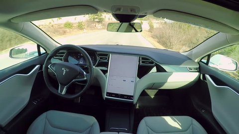 KARLSRUHE, GERMANY - FEBRUARY 1st 2017: Absolutely autonomous self-driving Tesla Model S car with next gen ultrasonic sensors, cameras and radars. A trully driverless car with empty seat and no driver