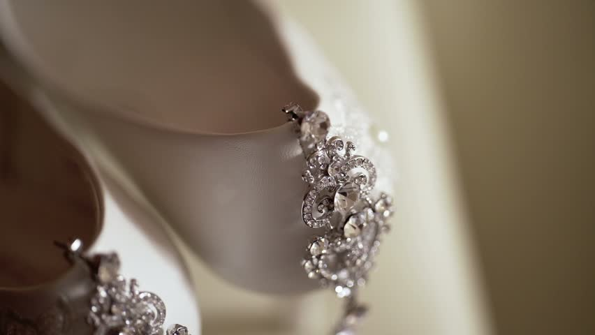 Stock Video Clip Of Beautiful Earrings And White Womens Shoes Closeup Shutterstock
