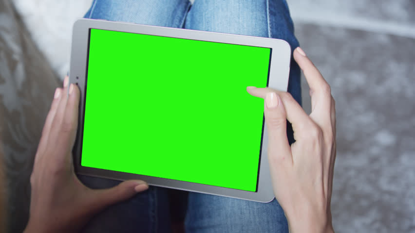 Young Woman sitting on the floor uses tablet PC with pre-keyed green screen. Few types of motion - scrolling up and down, tapping, zoom in and out. Perfect for screen compositing. 10bit ProRes 444 | Shutterstock HD Video #24586403