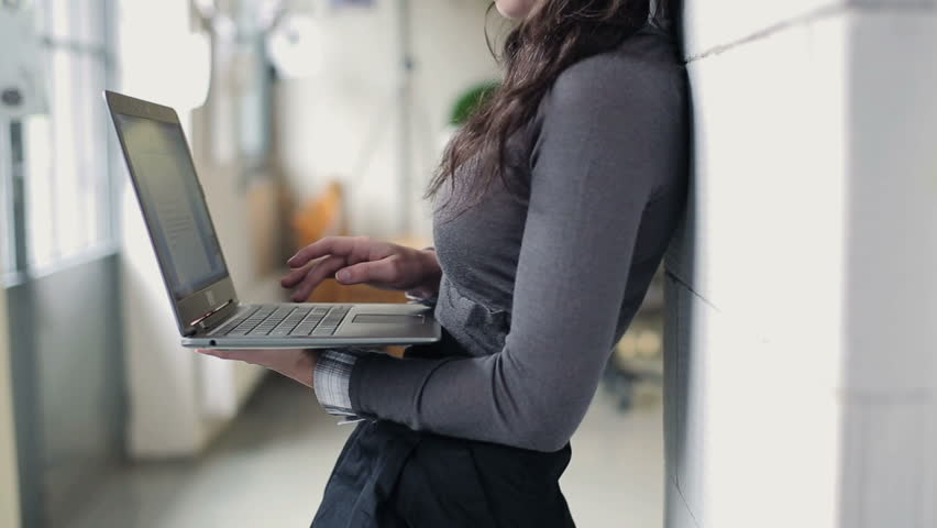 Businesswoman hands working on modern laptop in office