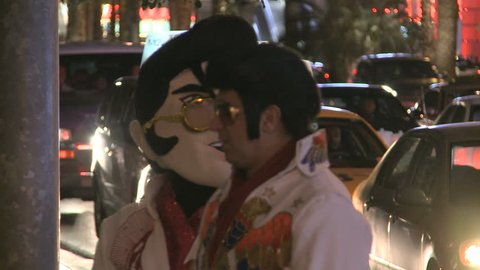 LAS VEGAS - MAR 1: An Elvis Look-alike and a person with an Elvis-mask at night on Las Vegas Boulevard on March 1, 2012 in Las Vegas, USA