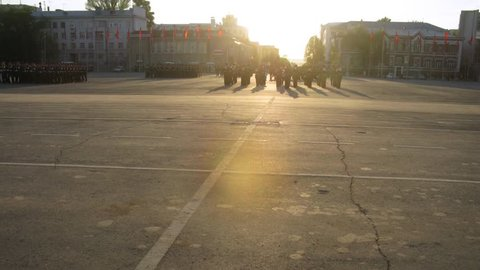 SAMARA - MAY 9: (Timelapse View) Military vehicles take part in military parade on area of Kuibyshev at sunset, on May 9, 2012 in Samara, Russia