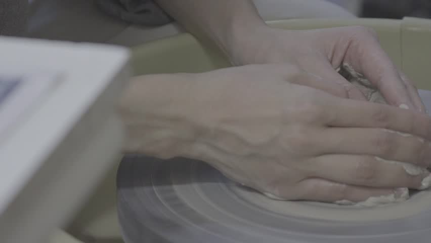 ceramicist hands creating round pot hd stock footage clip