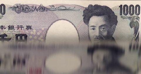 Loopable: Counting machine animation. Flipping 1000 Japanese Yen bills. Infinite flow of money. (av35413c)