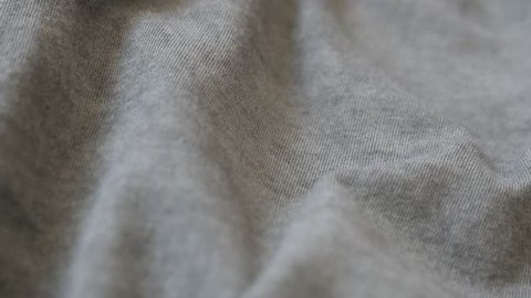 Shallow DOF gray modern clothing sample 2160p 30fps UltraHD  panning footage - Dark grey smoked color fine t-shirt fabric slow pan 4K 3840X2160 UHD video