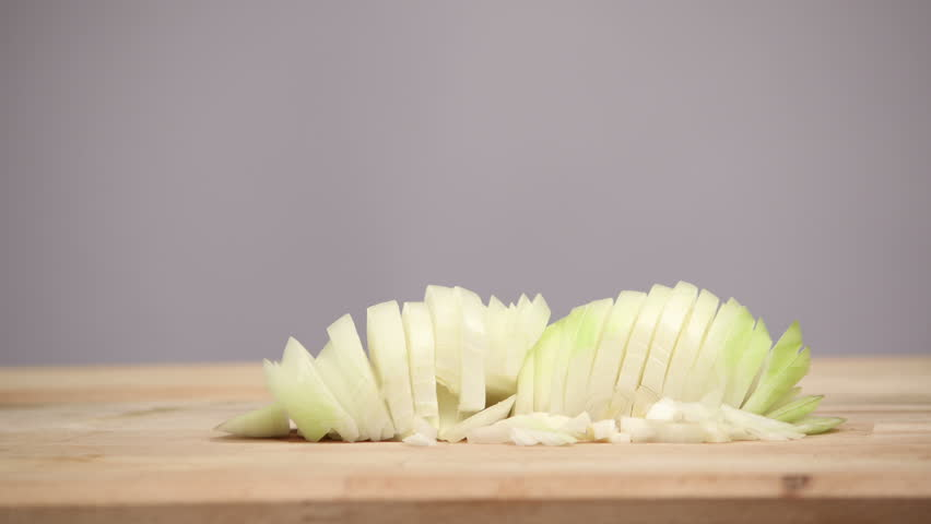 Cutting vegetables on wooden cutting board. Food stop motion animation.