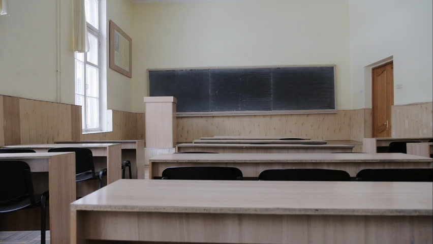 Empty classroom, lecture auditorium with wooden desks, chalk board