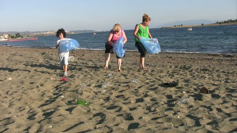 Cleaning up litter on the beach
