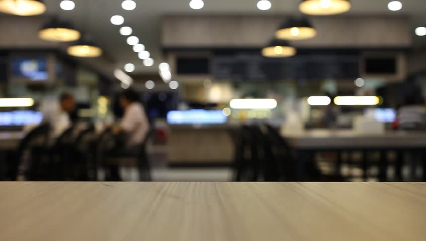 table and chair at food court blurred background