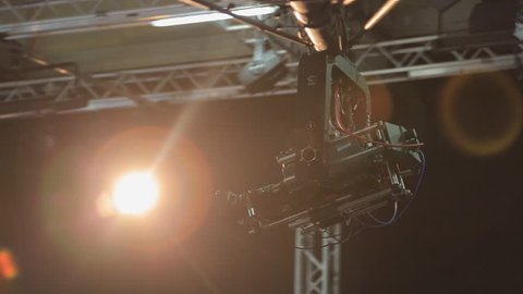 The camera on the crane moves in the pavilion during shooting