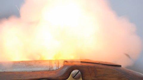 VIRGINIA - OCTOBER 2016 - Reenactment, Founding Fathers, American Revolutionary War era recreation -- Close Up of Patriot or British firing musket, with flash and smoke, flintlock. 2nd amendment, guns