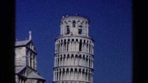 VENICE ITALY 1960: the leaning tower of pisa with a daytime crowd.