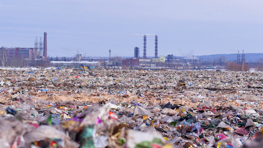 Garbage dump. Industrial factory on a background. Enviroment pollution concept. | Shutterstock HD Video #24819743