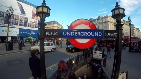 PICCADILLY CIRCUS, LONDON - MARCH 9, 2017. Amazing footage filmed in 4K using a large jib giving unusual and unique views of Piccadilly Circus, the Underground station, the crowds and buses,  Clip 14