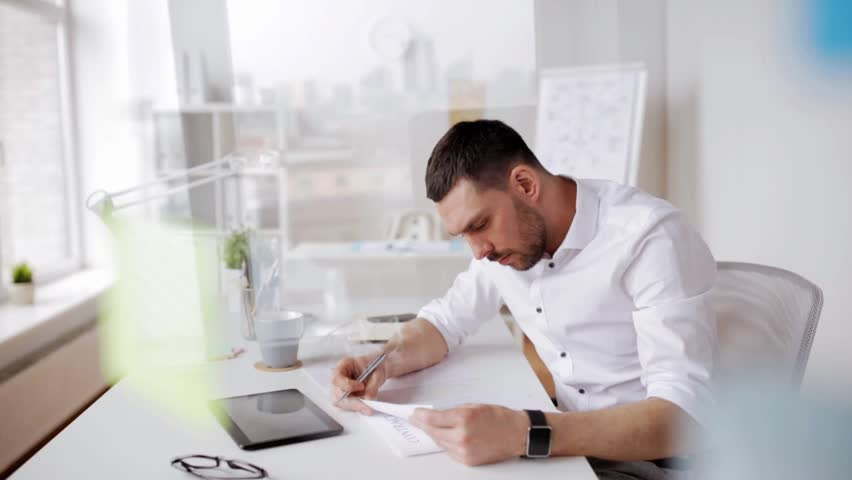 Business, people, paperwork and technology concept - businessman with tablet pc computer and papers working at office | Shutterstock HD Video #24849191