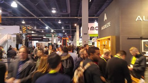 LAS VEGAS - January 07, 2017: Dynamic hectic hyperlapse walk through CES 2017 show floor in Las Vegas, Nevada. SEC is an annual consumer electronics trade show. 4K UHD timelapse.