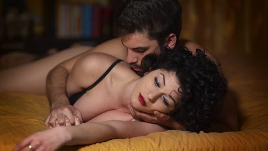 lovers in bed having sex: cuddling sensually
