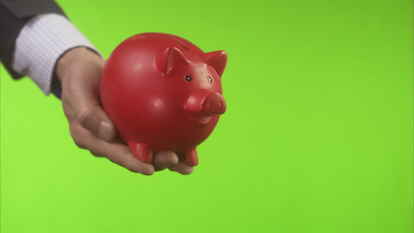 A red pig bank entering the picture. | Shutterstock HD Video #2491043