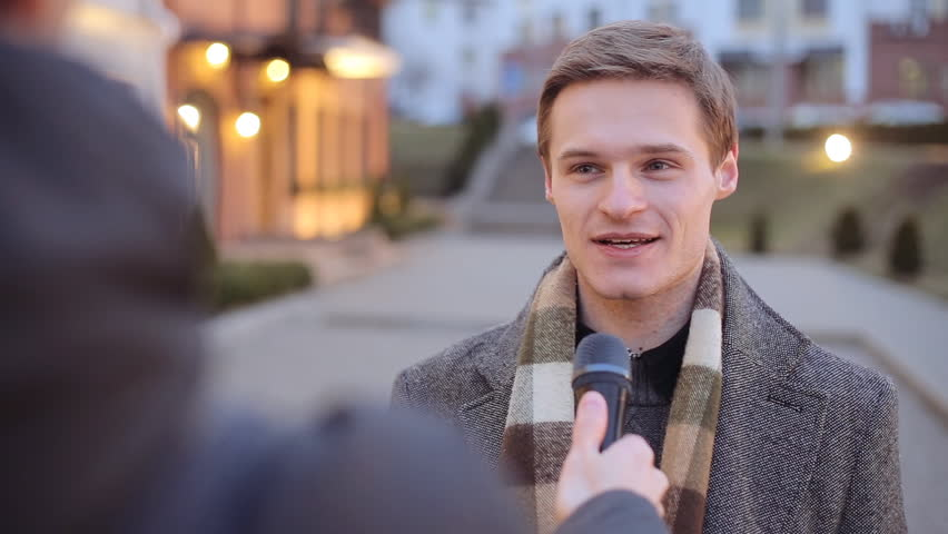 Attractive well dressed man being interviewed by a media journalist with a microphone | Shutterstock HD Video #24918986