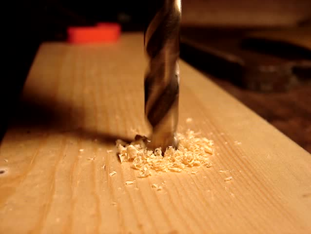A Drill Drilling Through Wood Stock Footage Video 100 Royalty Free