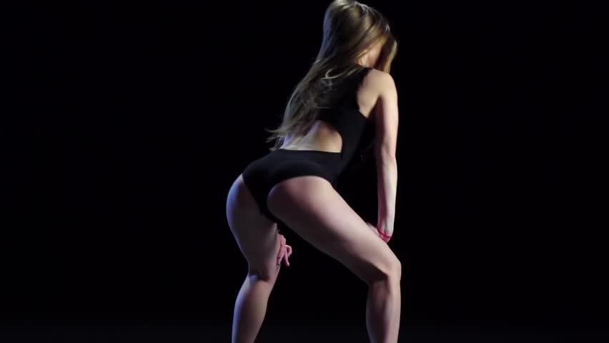 Sexy girl dancing in dark studio twerk dance. Slow motion