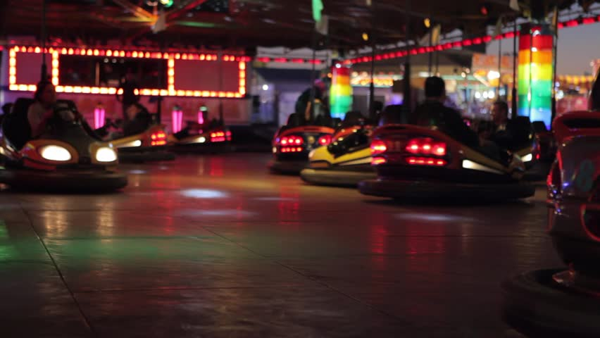 Bumper cars ride at a fun fair at night.