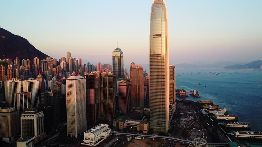 AERIAL. Top view of buildings in Hong Kong city at sunset.